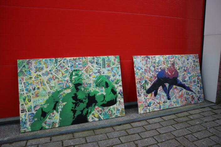 The Hulk and Spidey stenciled on a comic book background