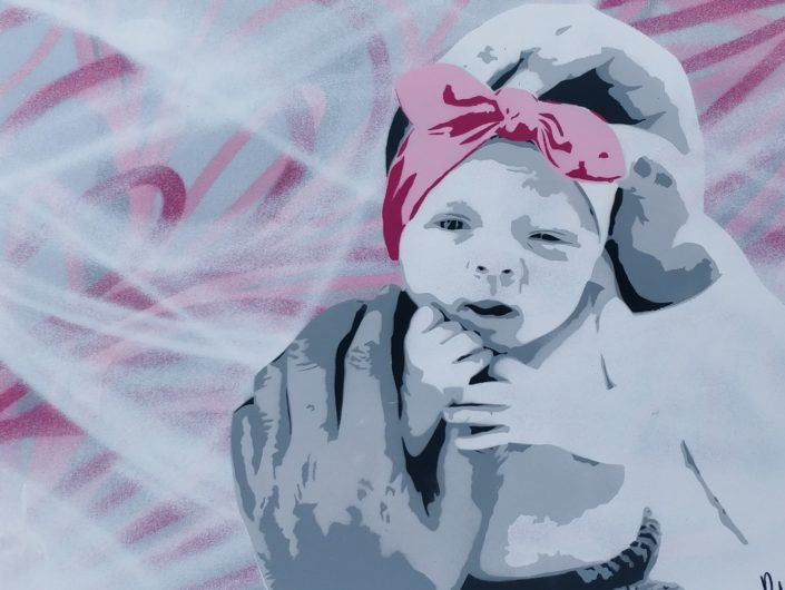 Stenciled and spraypainted canvas of a baby