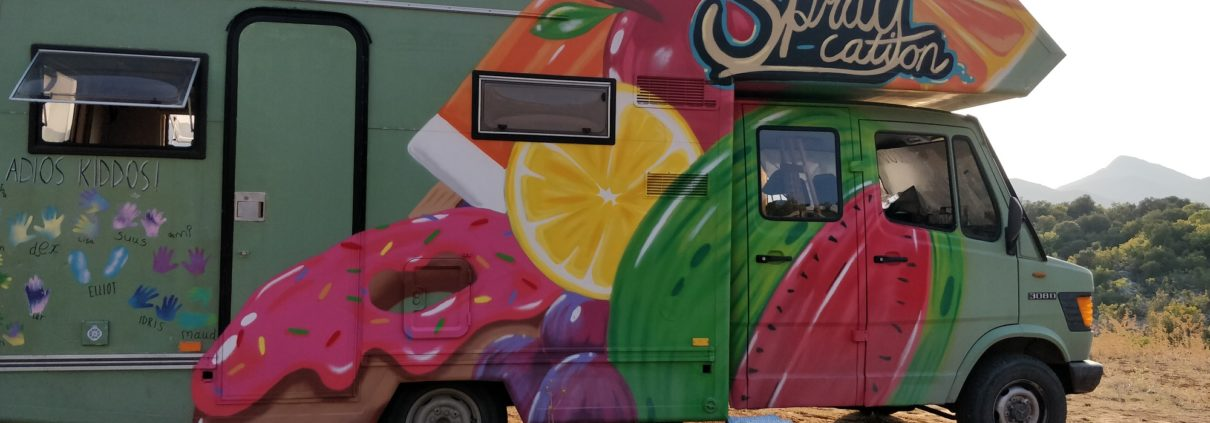 Who doesn't like spraypainted donuts on the side of a green camper?